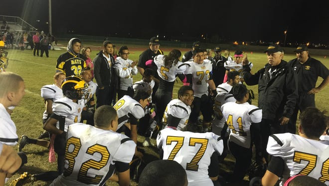 Parkland coach Jerry Walker talks to his team after they defeated Riverside 30-18 to improve to 3-2 in District 2-5A.