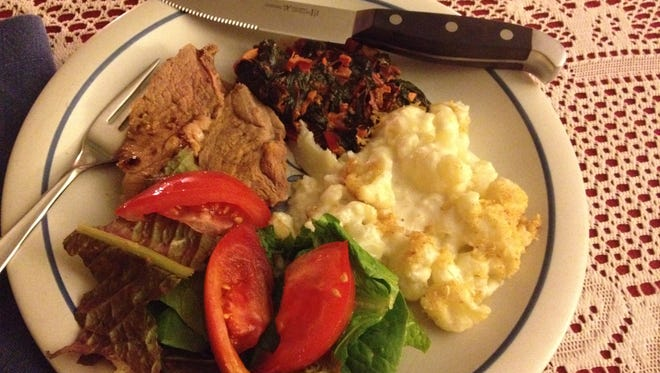 An autumn localvore dinner in late October featured cauliflower in cheese sauce, VErmont lamb and farmers market Swiss chard with Indian spices.