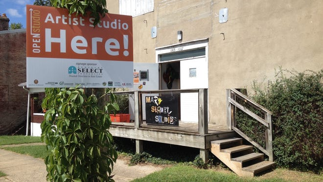 Signs are posted outside the studios of artists participating in one a past Open Studio Weekend.