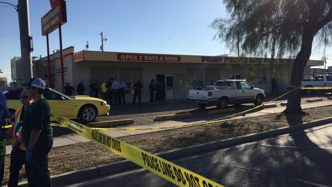 Armed robbery leaves one dead at Penny Pincher Auto Shop on W. Van Buren and 24th Ave.