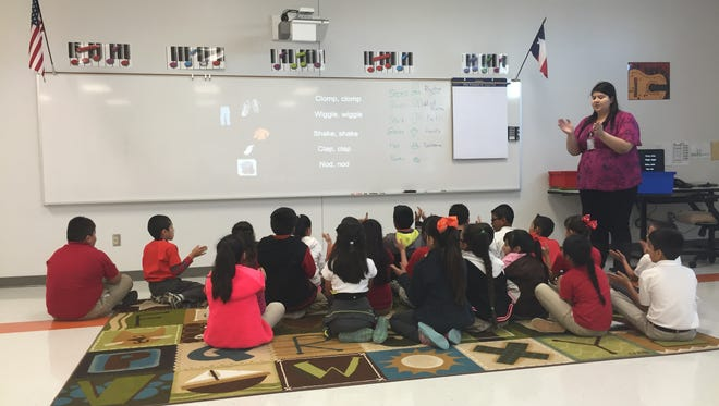 Mission Ridge Elementary School third-graders clap along to a song in music class on Oct. 26.