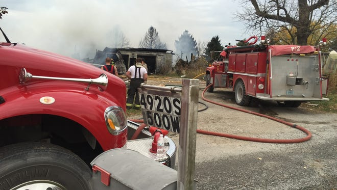 Crews from several fire departments responded to a house explosion Friday in southwestern Clinton County.