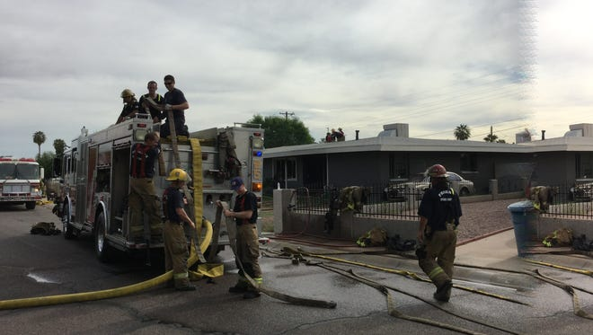 Phoenix firefighters respond to a house fire on Oct. 28, 2015.
