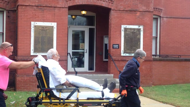Kahlil Muslimani, the defendant in a child rape case, is wheeled out of Accomack County Circuit Court after he complained of chest pains shortly before his trial was to begin on Wednesday, Oct. 28, 2015.