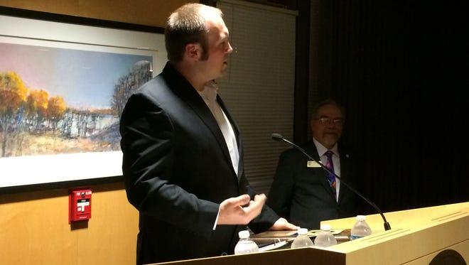 Greg Hedrich, of Chilton's LaClare Farms, accepts Marian University's Economic Development Award Tuesday.