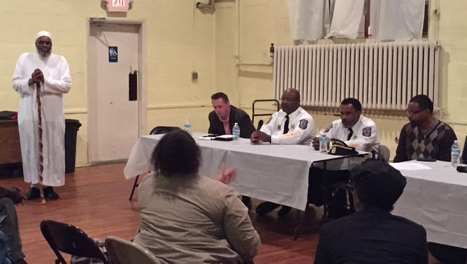 Panelists at the Public Safety Meeting in the Hilltop neighborhood listen to community concerns Wednesday night at the Be Ready Church on West Fourth Street.