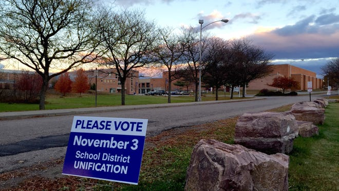 A sign at Essex High School encourages voters to weigh in on the creation of a new school district that would cover Essex Town, Essex Junction and Westford. The vote is Tuesday, Nov. 3.