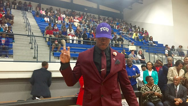 Isaiah Graham acknowledges the cheer at Bastrop High School after he verbally committed to Texas Christian University.