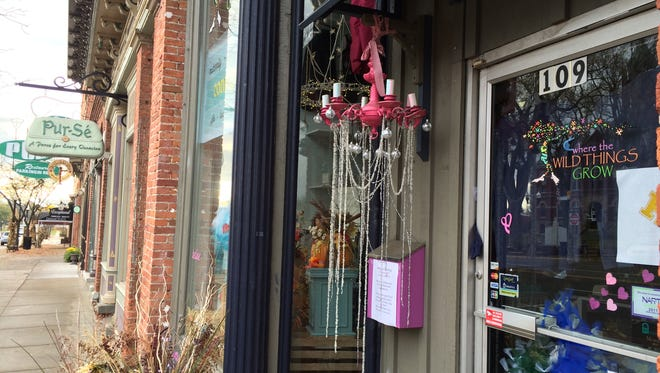 Where the Wild Things Grow, an upscale children's resale and gift shop, will move one door east in December into the spot currently occupied by Pur-sé, which is closing for good the same month.
