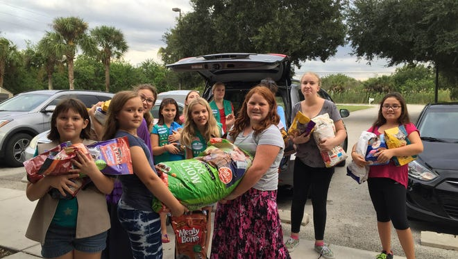The Satellite Beach Girl Scouts troop collected and donated pet food and supplies to the county's Melbourne animal shelter.