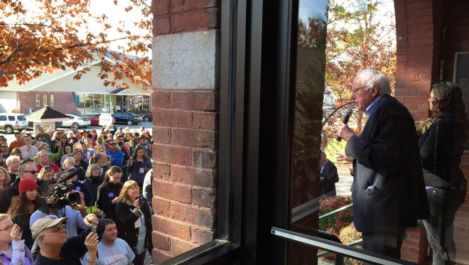 Bernie Sanders begins a presidential campaign event in Warner, New Hampshire on Saturday by speaking to more than 100 people who did not get a seat inside the town hall.