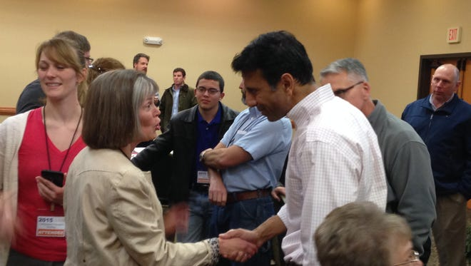 Louisiana Gov. Bobby Jindal greats one of the participants of Saturday's Caffeinated Thoughts Briefing.