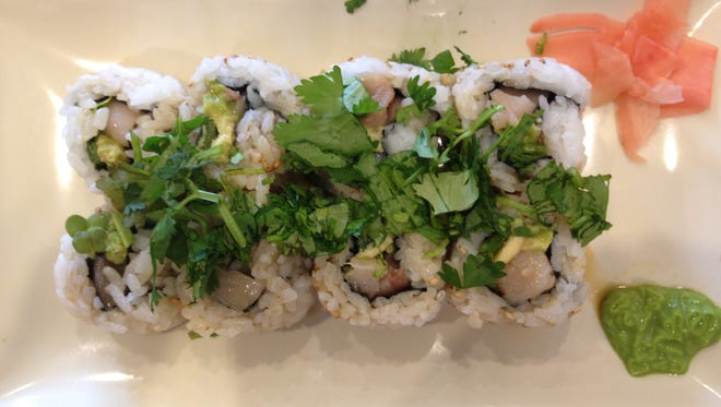 The Hoppin Hamachi Roll made with fresh yellow tail, avocado, sprouts, cilantro, sesame seeds and ponzu sauce at How Do You Roll in University Plaza at Gulf Coast Town Center.