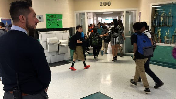 """Camino Real MIddle School Principal Charles Garcia tells students to """"walk with purpose"""" as they head to their next class on Nov. 2."""