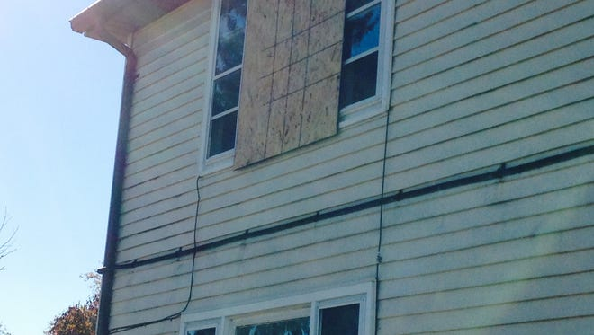 A home in the first block of Mayfield Streets in Dover remains boarded-up following a fire that occurred a week ago.