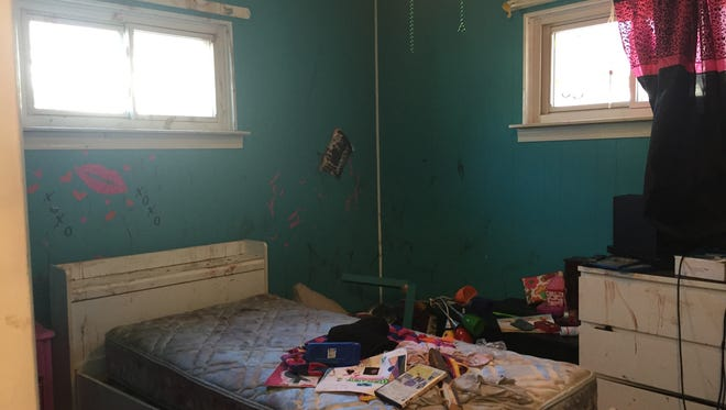 Feces, urine and blood from a six-point buck cover the walls and personal items today in 12-year-old Courtney Gietzen's bedroom at her family's home in Mt. Clemens. The deer jumped through a front picture window at the house on Crest on Nov. 3, 2015 and was corralled in her bedroom where it took Macomb County Animal Control three tranquilizer shots to sedate the panicked deer.