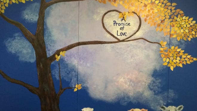 Muncie Artists Guild members Susie Burns, Debra Brown and Jean McCauley recently painted this mural at the Animal Rescue Fund.