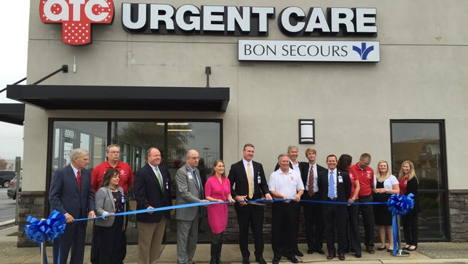 Bon Secours St. Francis Health System CEO Craig McCoy cuts the ribbon at the AFC-Bon Secours Urgent Care center in Simpsonville Thursday morning.