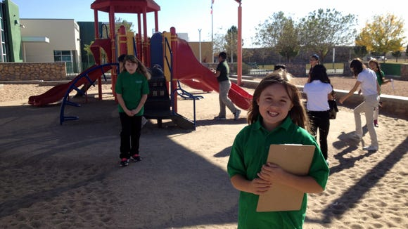 Chester E. Jordan Elementary Schol third-grader Danielle McKown shows off the school playground, made of recycled materials.