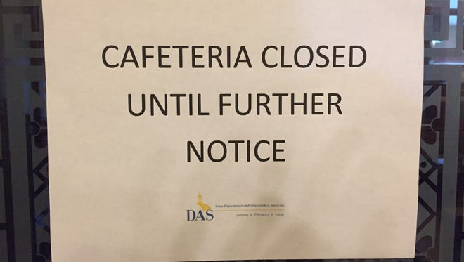 People who want to buy a hot meal at the Iowa Capitol for breakfast or lunch are being greeted by this sign saying the operation is closed until further notice. The food service operation is expected to be back in business under another vendor by the time lawmakers return in January for their 2016 session.