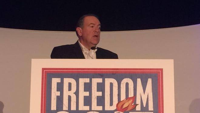 Former Arkansas Gov. Mike Huckabee speaks during the 2015 Freedom Conference in Des Moines Friday morning.
