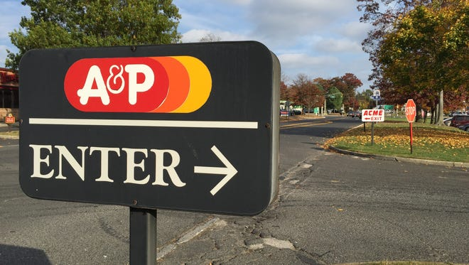 An old A&P sign still stands in the parking lot of the new Acme on Route 35 in Wall. A new Acme sign stands in the background