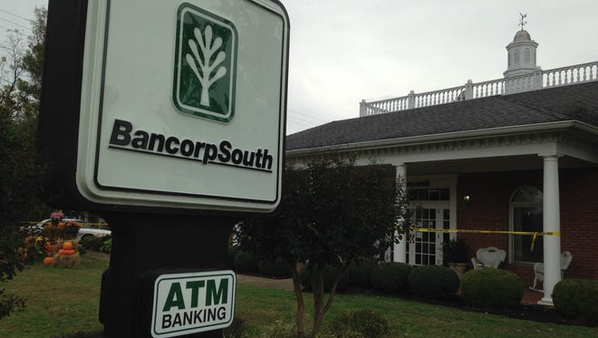 Crockett County sheriff's deputies arrested two suspects Friday morning following a bank robbery in Alamo. Crime-scene tape blocked off the BancorpSouth branch in Alamo.