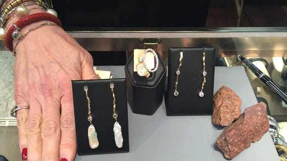 Susan Eisen, of Susan Eisen Fine Jewelry & Watches, displays her Franklin Rock Collection, a collection of jewelry pieces that take inspiration from the Franklin Mountains.