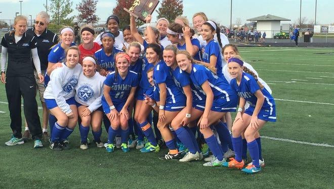 The Summit girls' soccer team celebrates its win against Badin on Saturday.