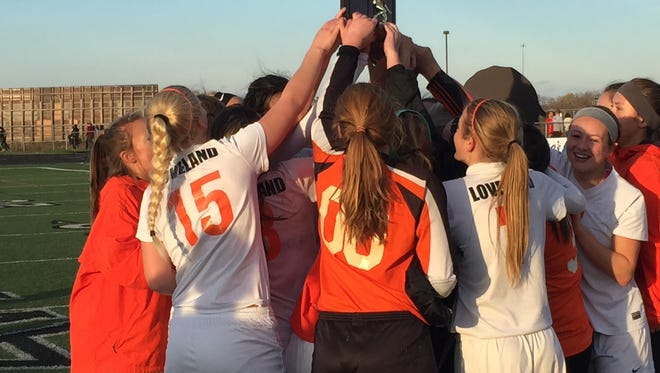 Loveland's girls' soccer team celebrates after Saturday's win against Springboro.