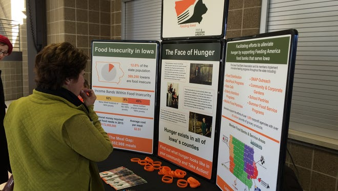 Participants read statistics on hunger in Iowa at the Vote to End Hunger rally Sunday at Grand View University.