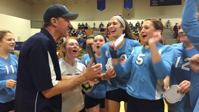 Pine Plains volleyball coach Larry Strickland, left, celebrates with his team after the Bombers won the Section 9 Class D title in Newburgh on Nov. 8, 2015.