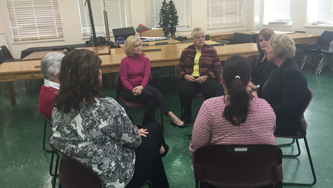 Foster care parents meet during a recruitment session