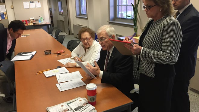 George Hanley and Helen O'Connor examine provisional ballots from Morris Township while committee candidate Cathy Wilson, standing, takes notes Monday in Morristown.
