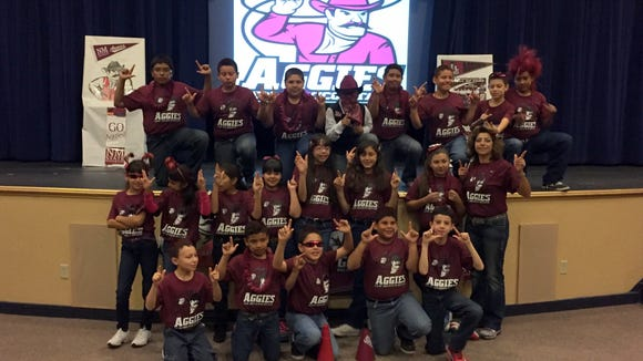 Johanna O'Donnell Intermediate School fifth-graders show off their New Mexico State University gear.