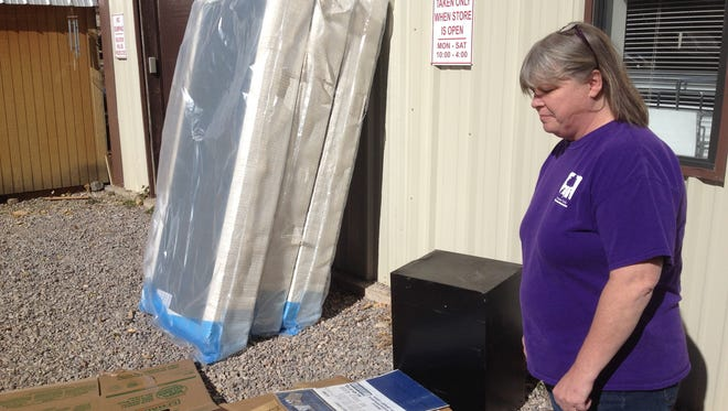 Trish Watson of the Humane Society of Lincoln County surveys the drop-off zone for resale items where thieves regular help themselves.
