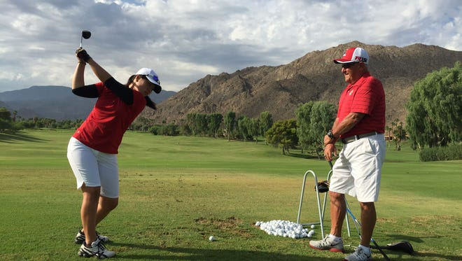 College of the Desert Roadrunners women?s golf coach Gary Sabella watches his team's top player Fumika Matsumoto practicing on the driving range at Ironwood Country Club in Palm Desert.