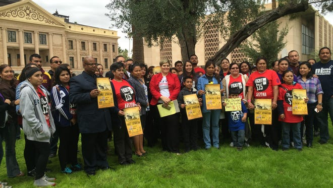 Several immigration-reform groups gathered on the Arizona Capitol lawn Tuesday morning to express their frustration over a ruling by the 5th U.S. Circuit Court of Appeals concerning deportations.