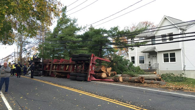 An overturned log truck and downed utility pole shut down Route 9W between Ten Eyck Street and Walnut in Stony Point, Nov. 11, 2015