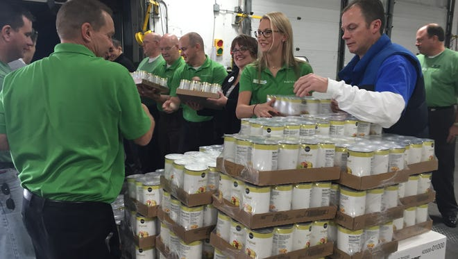 Publix employees unload a tractor filled with 22 pallets of food that the grocery retailer donated to Harvest Hope Food Bank in Greenville.