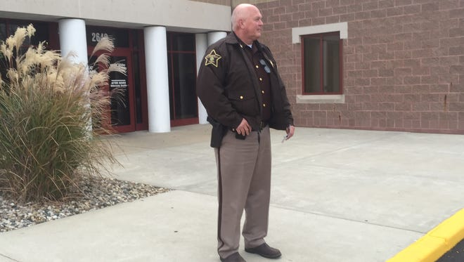 Tippecanoe County Sheriff Barry Richard waits outside his office for a suspect in an I-65 chase Thursday afternoon.