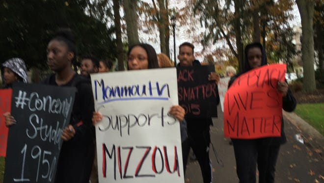 Monmouth University students march in solidarity with Mizzou students.