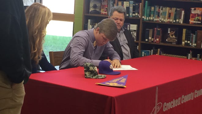 John Elford signs his national letter of intent to play baseball at Tennessee Tech at Crockett County High School on Thursday.