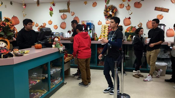 Students stop in the store run by their classmates at the Center for College and Technology Education.
