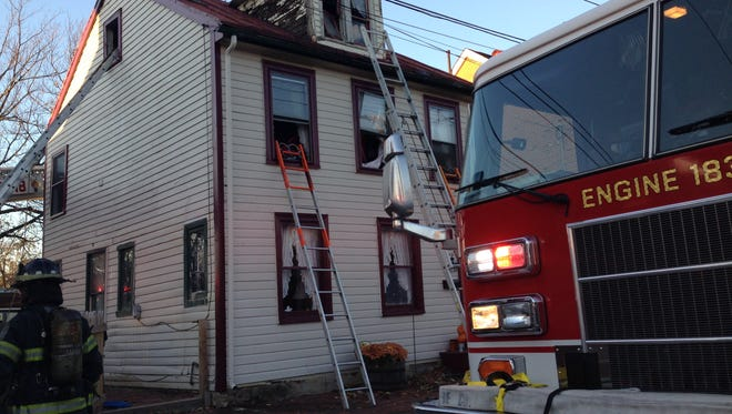 Emergency crews respond to a fire at a home in downtown New Castle on Saturday afternoon.