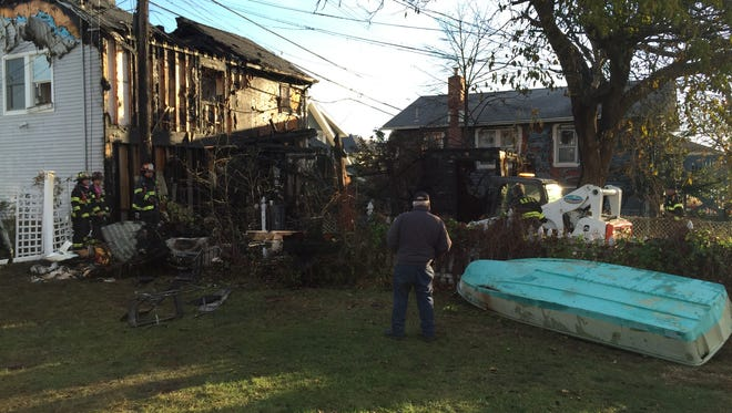 - A shed fire spread to three Bradley Beach homes early Sunday morning and displaced two Beach Avenue families, police said