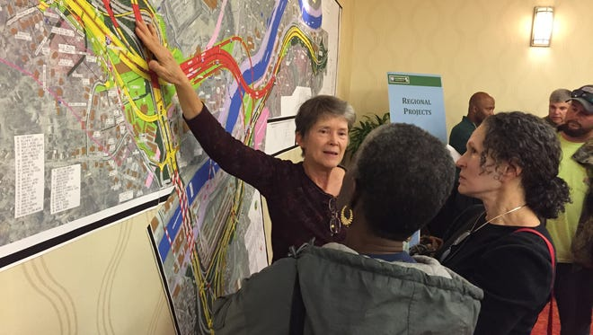 Local residents look over a map of one of four alternatives proposed for the portion of the I-26 Connector to be located near Bowen Bridge.