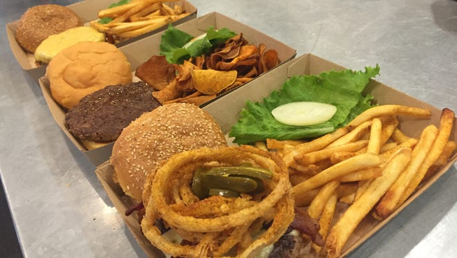 The Twisted Root offers a variety of burger options. The Western (farthest right) is the restaurant's most popular