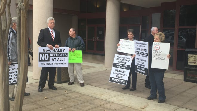 People opposed to refugee resettlement demonstrated in front of Greenville County Square last November. The county council later unanimously approved a resolution opposed to the resettlement of refugees in Greenville County.