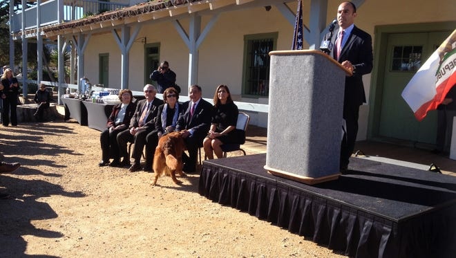 Jimmy Panetta addresses a crowd of supporters Tuesday at the Custom House in Monterey. At left are his wife, Carrie, parents Leon and Sylvia Panetta, family dog Bravo and his parents in law from Arizona.